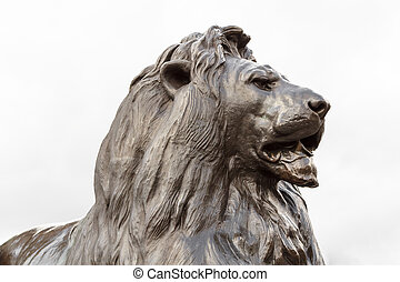 Bronze lion sculpture in on Trafalgar square, London