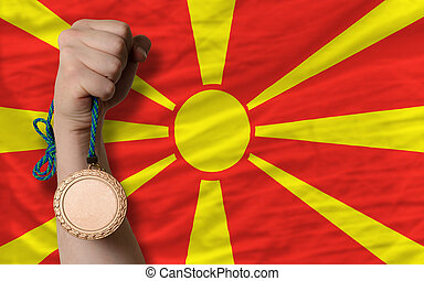 Bronze medal for sport and national flag of macedonia