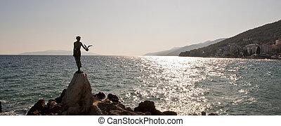 Bronze monument on the sunny coast