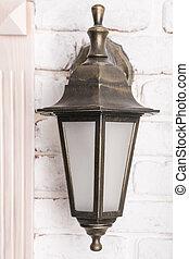 Bronze retro lamp on the wall