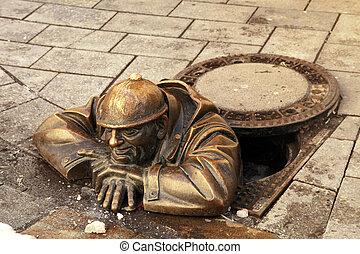 bronze sculpture called man at work, Bratislava, Slovakia - ...