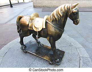 bronze sculpture carved in the shape of horse