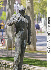 bronze sculpture of a bullfighter in a park