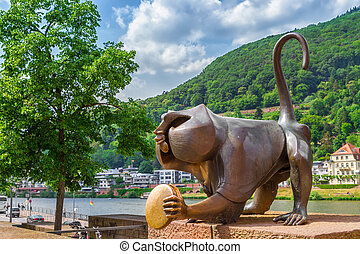 Bronze sculpture of a monkey on the old bridge. Heidelberg. Germany