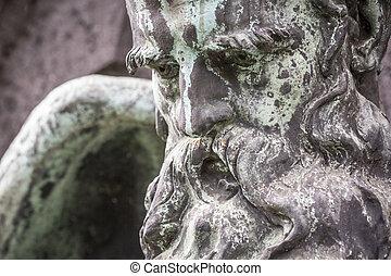 bronze sculpture of an old bearded man