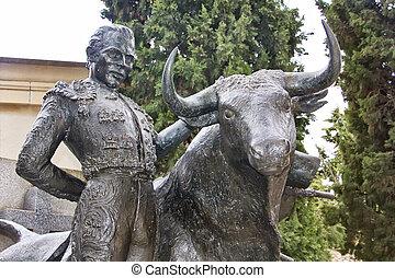 bronze sculpture of matador bullfighting
