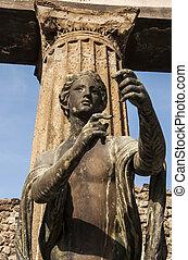 bronze statue inside the pompeii ruins, italy