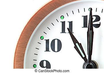 bronze vintage alarm clock isolated on white background