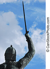 Bronze warrior with sword raised