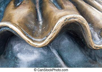 bronze wavy texture. background.