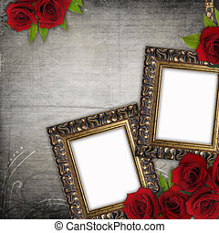 Bronzed vintage frames on old grunge background with red roses and lace