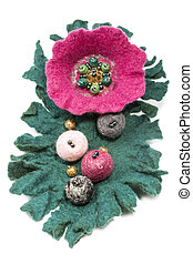 Brooch made of felted wool on a white background