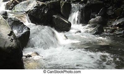 Brook flowing stone steps