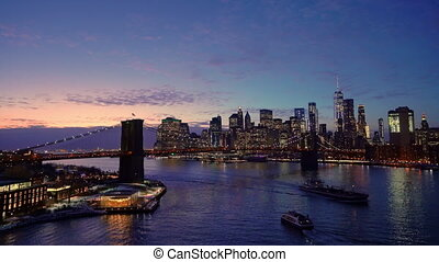 Brooklyn bridge and Manhattan after sunset - Panoramic view...
