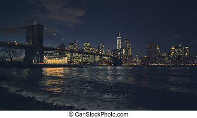 Brooklyn bridge and Manhattan at night, New York City.