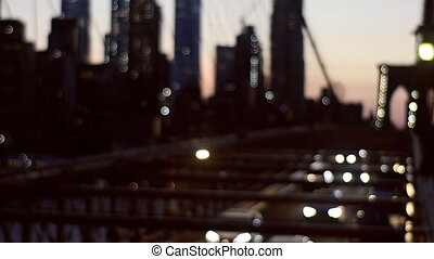 Brooklyn Bridge at night time with car traffic view from above of the busy roads of New York soft focus