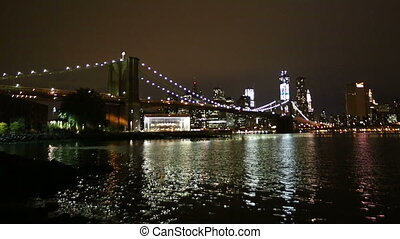 Brooklyn Bridge at Night with Manhattan in Background