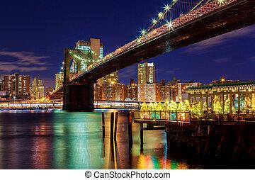 Brooklyn Bridge closeup over night in New York City Manhattan with lights