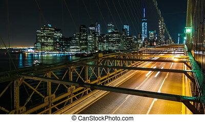 Brooklyn Bridge, New York City - Night Traffic on the...