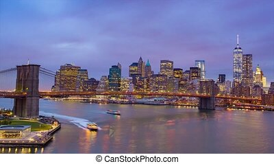 Night view of Manhattan and Broolyn Bridge. New York City. Downtown.