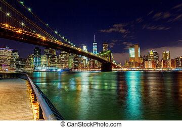 Brooklyn Bridge over East River night in New York City