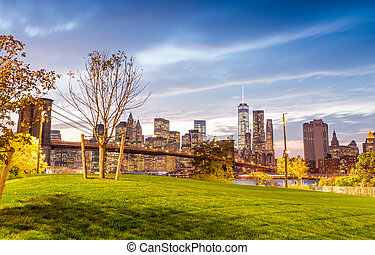 Brooklyn Bridge Park at twilight with Manhattan skyline on background