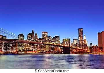 Brooklyn bridge with New York City Manhattan downtown