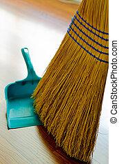 Broom and Dust Pan - Broom and dust pan on hardwood floor.
