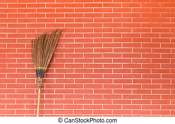broom on brick wall - broom on red brick wall