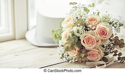 Broom white hat and bridal bouquet