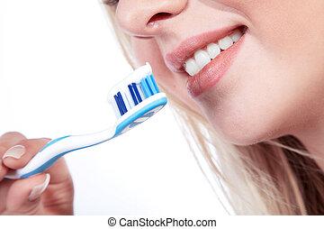 brossage, femme, jeune, dents