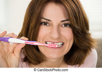 brossage, femme, jeune, elle, dents