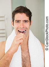 brossage, salle bains, homme, jeune, dents
