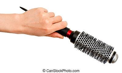 brosse cheveux, main