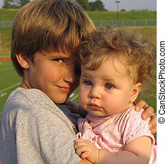 Brother and Sister - 10 year old boy and his baby sister