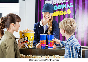 Brother And Sister Buying Popcorn From Seller In Cinema