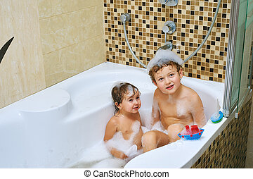 brother and sister fun take water treatments. Children in the bathroom