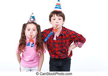 Brother and sister having fun at the party