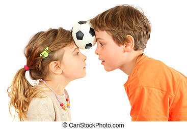 Brother and sister hold their heads little ball and look at...