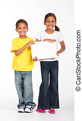 brother and sister holding board