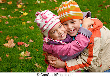 Brother and sister hugging - sister and brother embrace in...