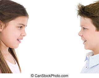 Brother and sister looking at each other smiling