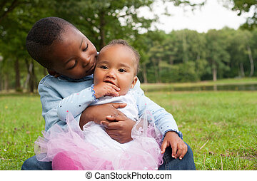 Brother and sister love - Happy little children are having a...