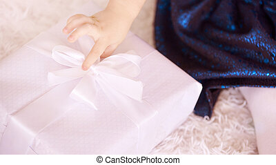 Brother and sister. New Year xmas child. Christmas eve holiday. Large gift box. White color. Blue dress