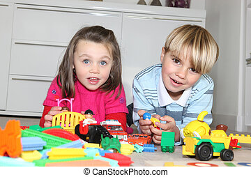 Brother and sister playing with toys