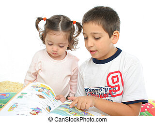 Brother and sister reading a book on the floor