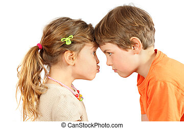 Brother and sister rested their foreheads and look at each other isolated on white background