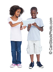 Brother and sister using tablet pc