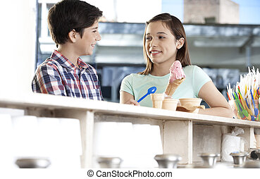 Brother And Sister With Ice Cream Looking At Each Other