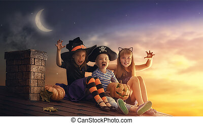 brother and two sisters on Halloween - Happy brother and two...